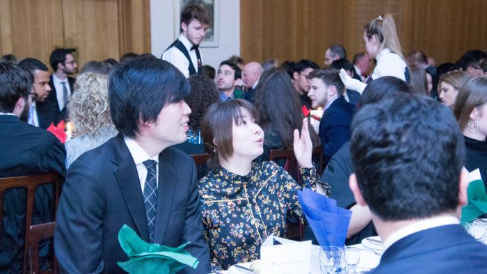A man and woman at Burns' night Formal Hall