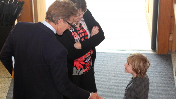 The President Jane Clarke with an alumnus and child