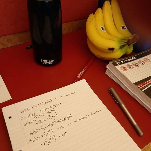 Notebooks and a banana in the library