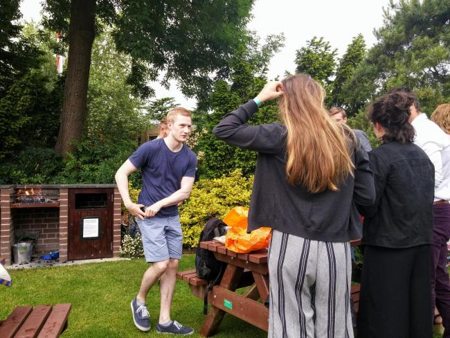 Students cooking at the barbecue in the Sundial garden
