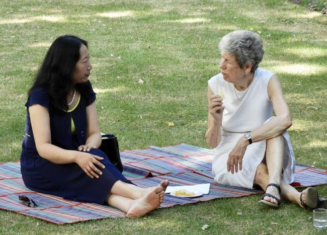 CRA garden party 2018, two women having a picnic