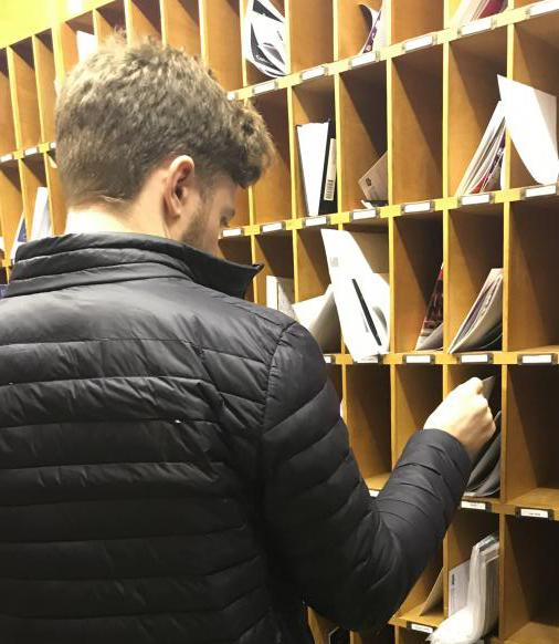 Student checking his pigeonhole for mail