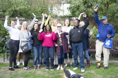 Students and Staff from the Open Book Project celebrate their time at Wolfson College (30 August 2018). From left to right: Kelly, Michelle, Carolyn, Sarah, James, Tracie, Jennifer, Susan, Fiona, Jerry, Judith, David. Foreground: Banjo.