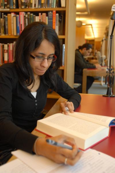 Student studying from a book in Wolfson Libary