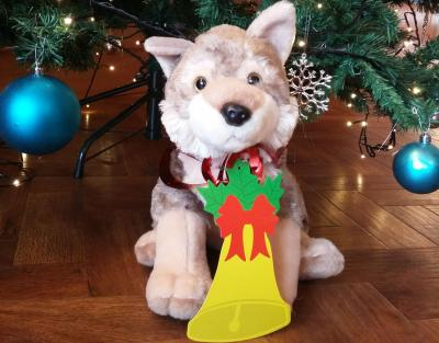 Virginia the toy wolf under the Christmas tree