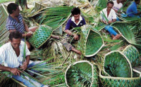 workers with palm fronds making baskets