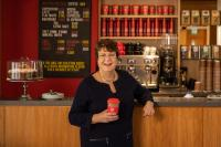 President Jane Clarke with a coffee